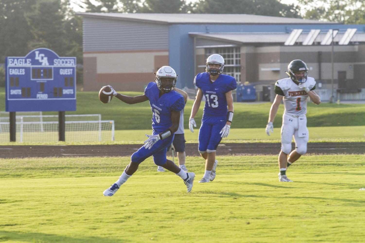 Dee Smith, 11, rushes against Vincennes