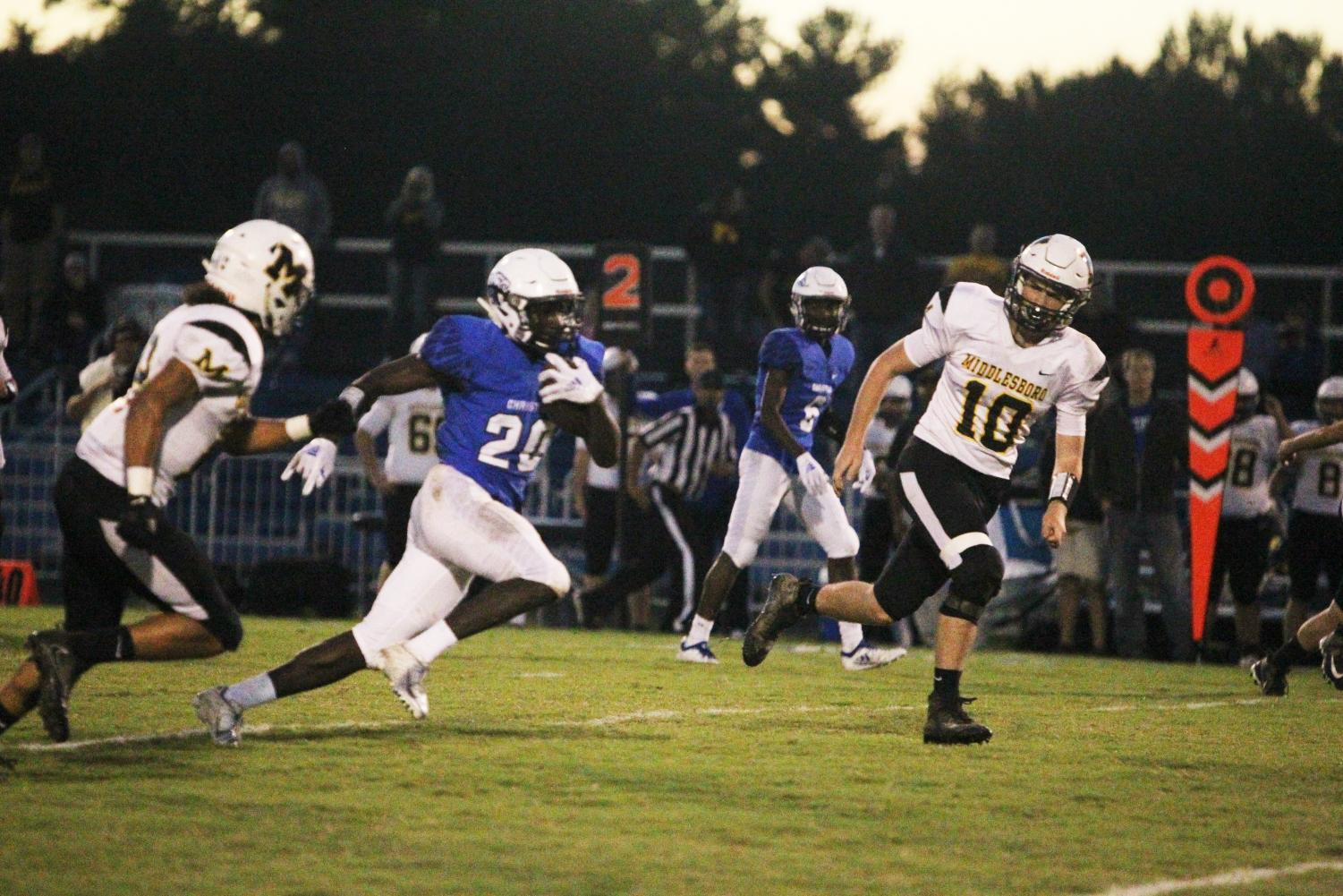 Freshman Xavier Brown eludes Middlesboro players on his way to a touchdown in the Eagles' decisive victory.
