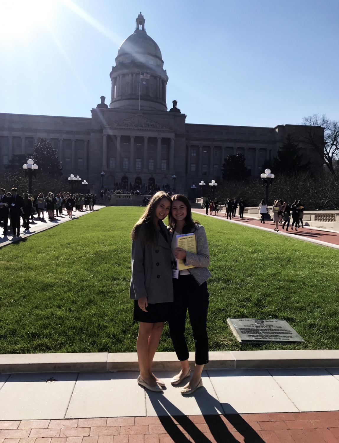 Seniors Erin Oliver and Katherine Childers stand in front of the capitol building in Frankfort.  They visited Frankfort as part of the KYA.