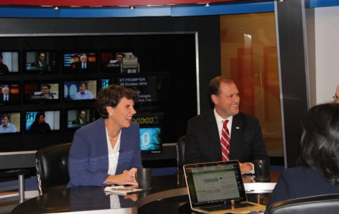 Amy McGrath (D) and Congressman Andy Barr (R) in a light moment before the debate begins.