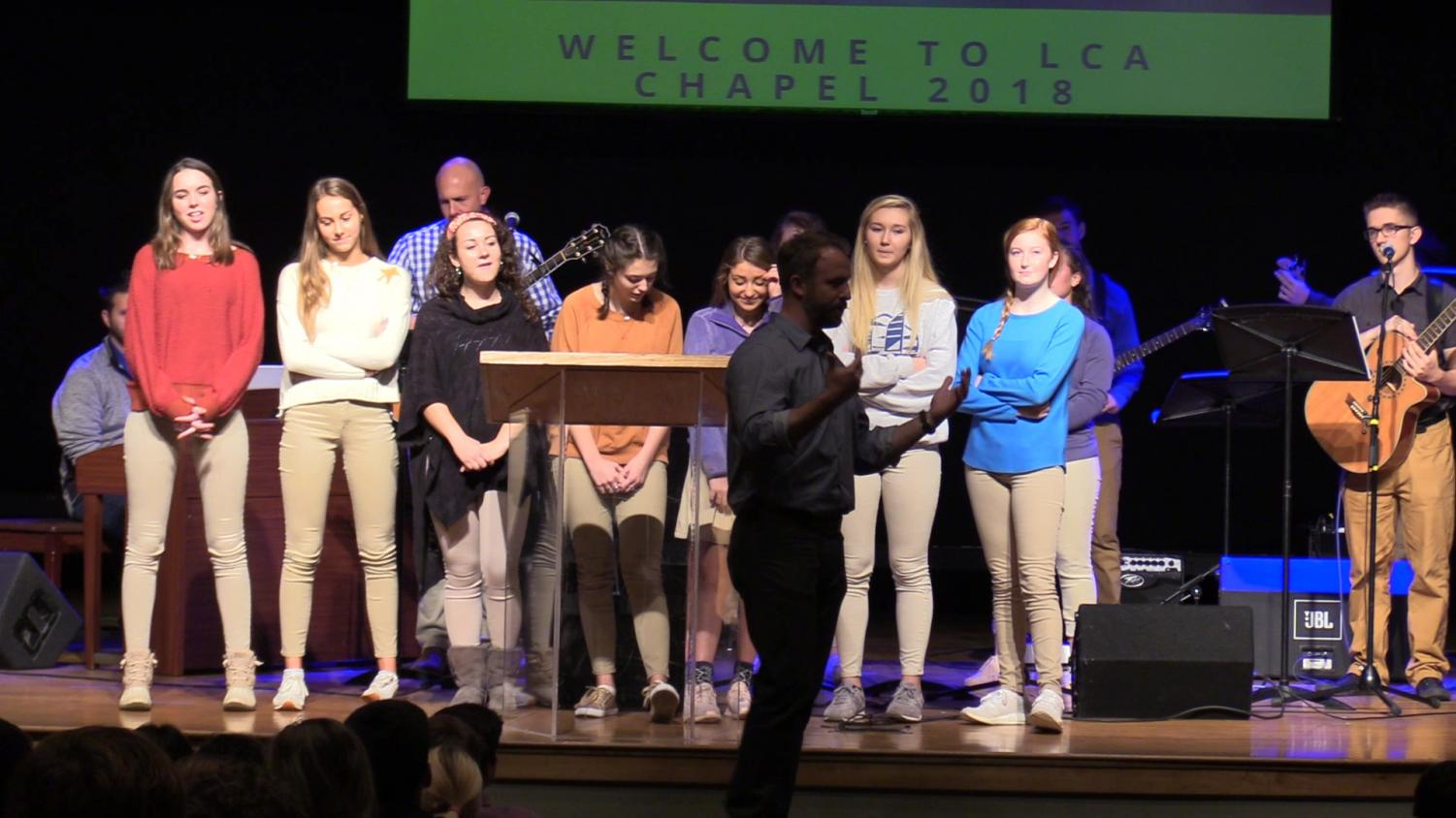Senior girls take the stage during chapel on Oct. 31 to model acceptable responses to the No Polo November drive.