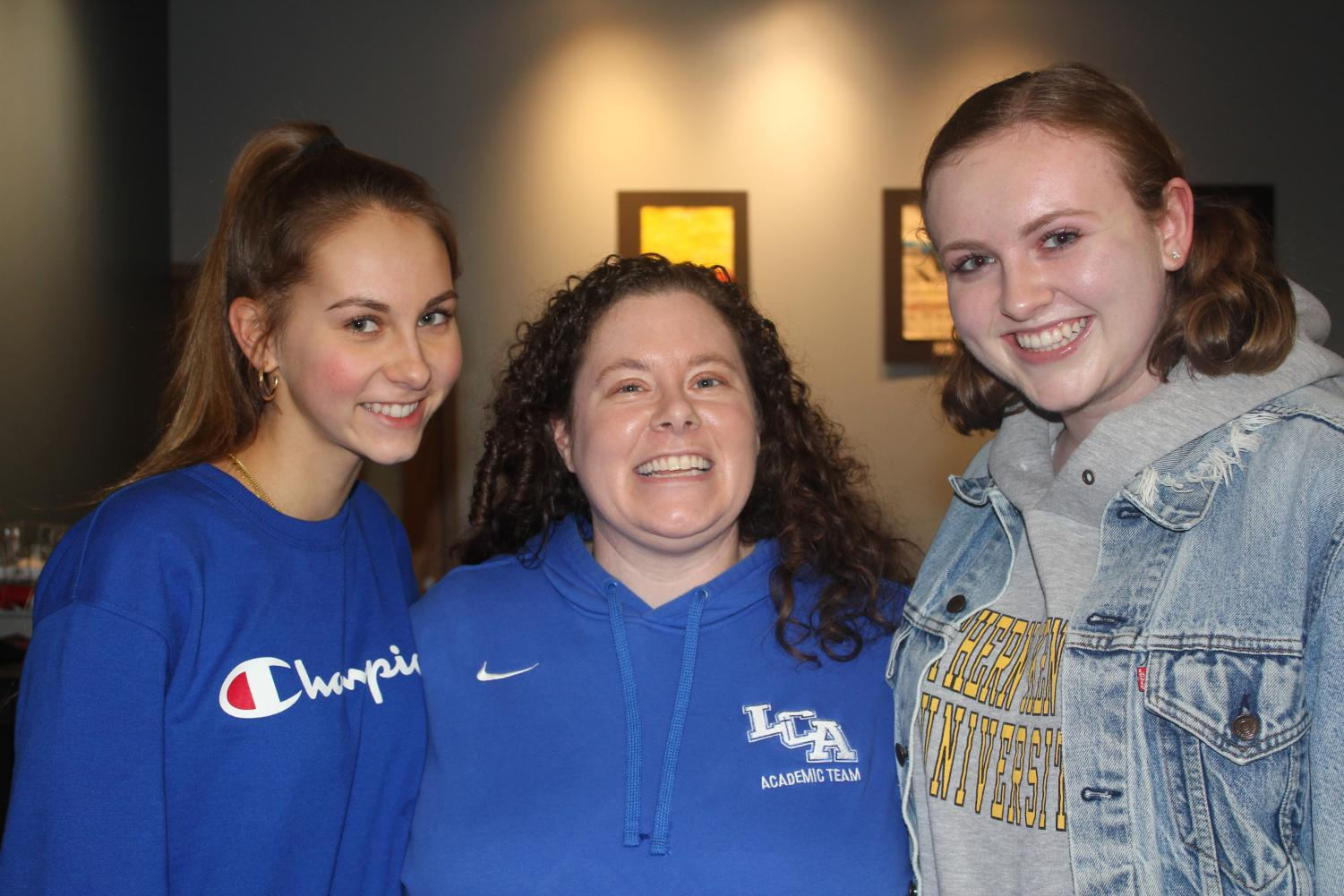 Erin Oliver, 12, and Hope Marcum, 12, pose with Ms. Groves who has developed a special relationship with many students during her tenure at LCA.
