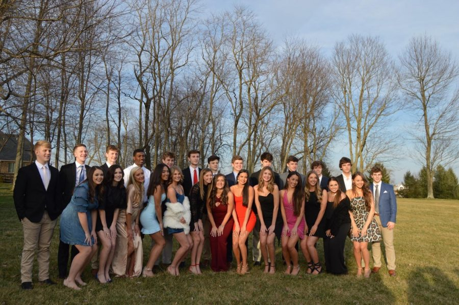 A+large+group+of+students+gather+for+pictures+before+the+Sadie+Hawkins+Dance.