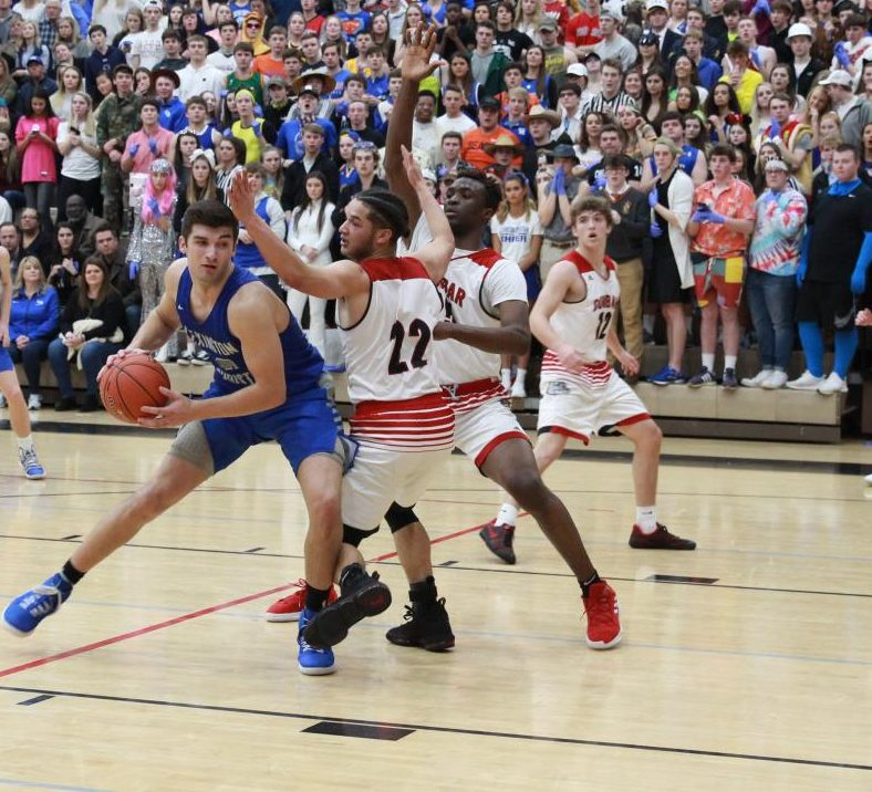 Kyle Rode, 12, drives past a defender in the district championship game against Dunbar.