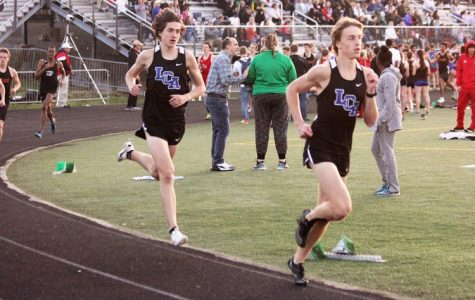 Connor Hayes , 11, and Andrew Madden, 12, compete in the Tates Creek Meet