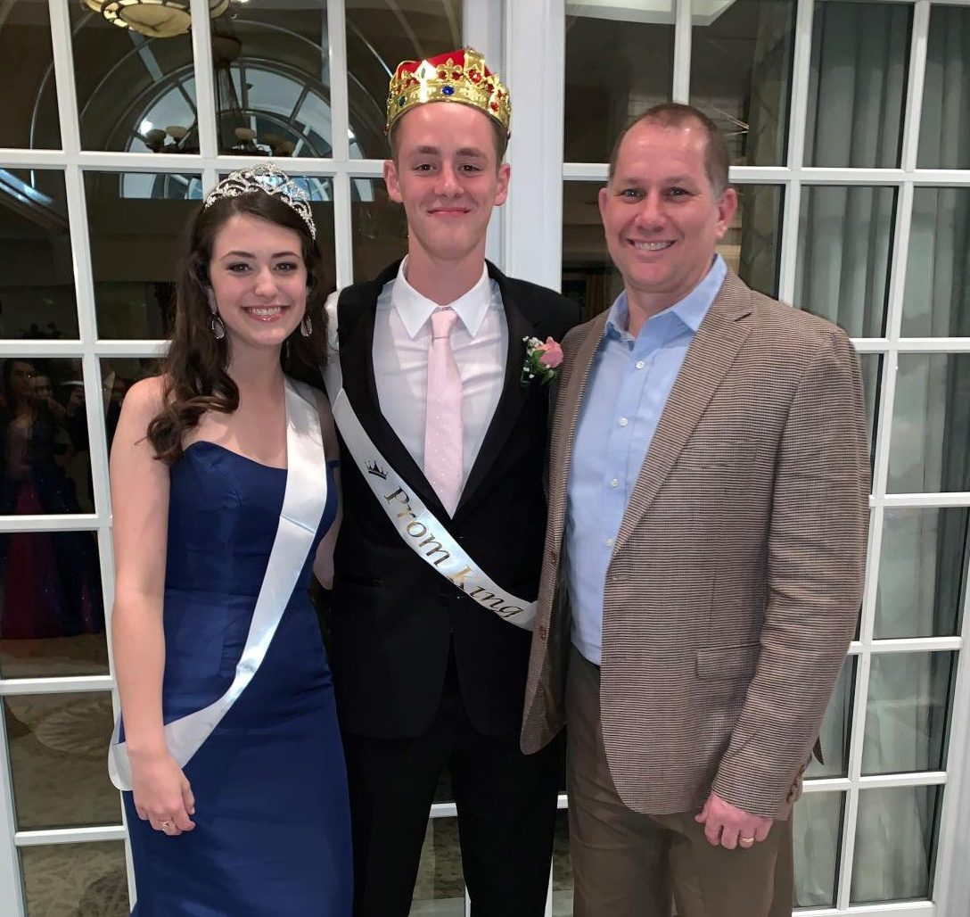 Principal Mr. Matthews poses with Prom King and Queen Samuel Martin and Katherine Childers.