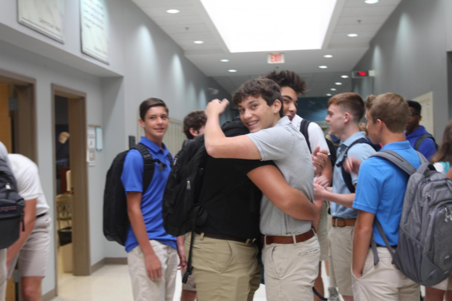 Grant Vaught, 10, and Mac Crosbie, 10, welcome each other to school on the first day.