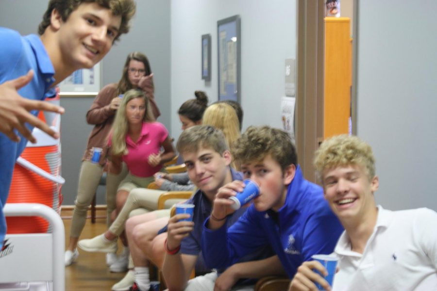 Students make the most of their time as they wait for random drug testing in the office.