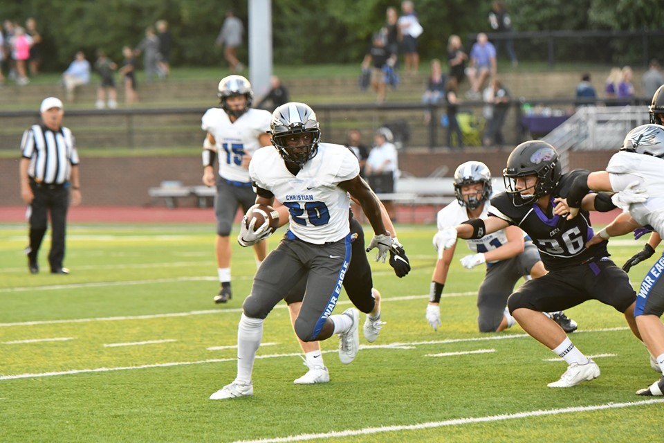 Xavier Brown, 10, carries the ball in the Eagles victory over Cincinnati Hills.