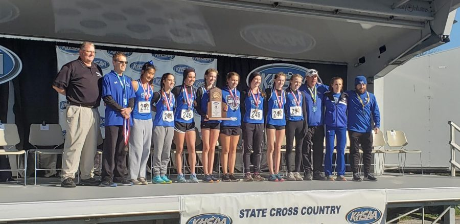 The+girls%27+cross+country+team+takes+the+podium+with+their+third+place+finish+at+state.