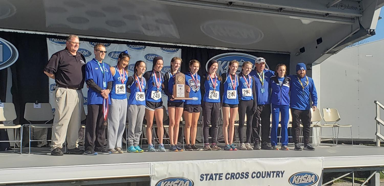 The girls' cross country team takes the podium with their third place finish at state.