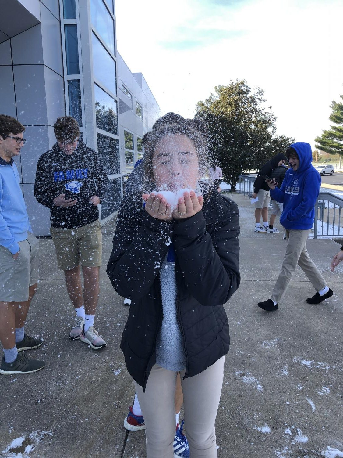 Maryssa Phillips, 9, plays in the snow while her photography class is outside taking pictures of the snow.