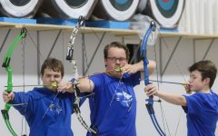 Jack Lankford, 11, AJ Bateholts, 11, and Zachary Washnock, 10, get ready for the archery tournament hosted at LCA.