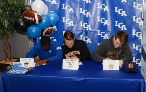 Seniors Dee Smith, Jayden Barnhardt, and Drew Long sign their letters of intent to play football in college.