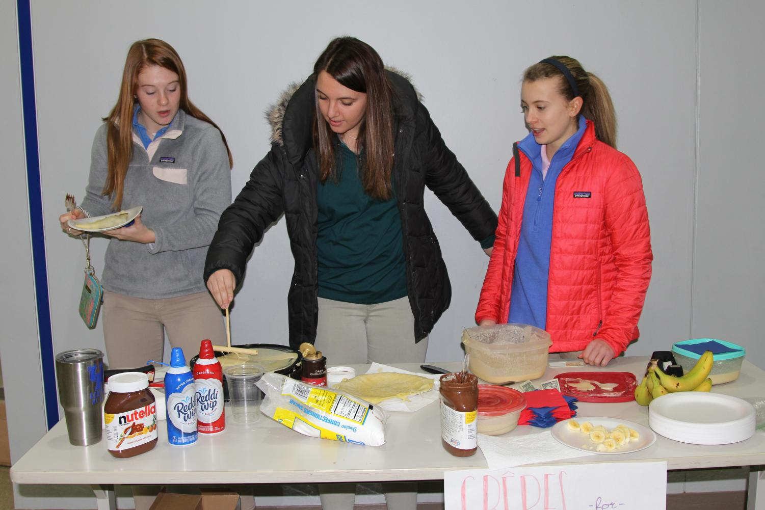 The French club makes crepes before school.  Ellie McCallum, 10, Hadley Whipple, 10, and Emily Howell, 11.