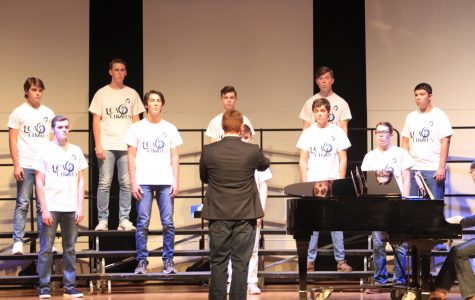 Mr. Wesley directs members of Cantare, the men's chamber chorus during their fall concert.