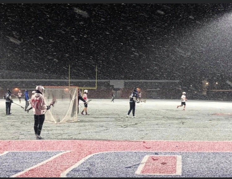 The+lacrosse+team+weathered+snow+and+cold+temperatures+for+their+first+game.+Players+intend+to+weather+the+current+delay+in+their+season+as+well.