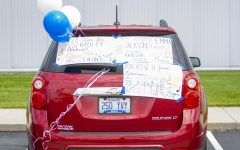 Mr. Wesley uses his car to celebrate all of his chorus seniors.
