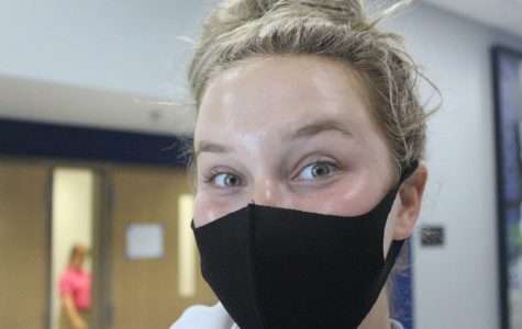 Senior Emilie Teall does not like wearing a mask all day, but she takes it in stride in order to attend school in person.