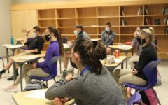 Student Council members gather in a socially distant room to discuss plans for upcoming school events.