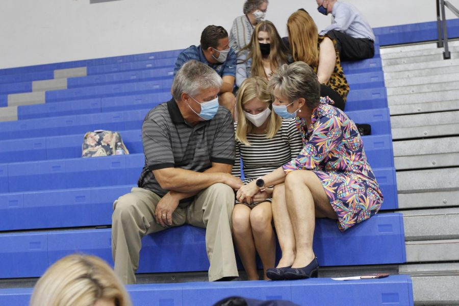 Jordyn Martin, 12, and parents gather for pray for her senior year.