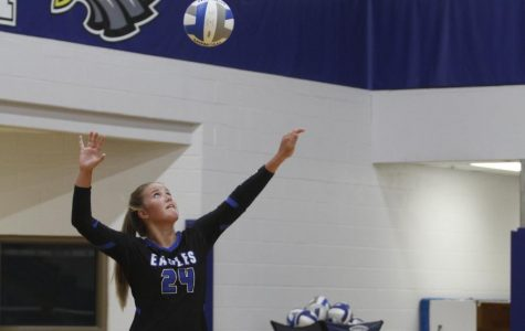 Emma Claire Sapp, 12, serves the ball during the season opener and senior night for the volleyball team.