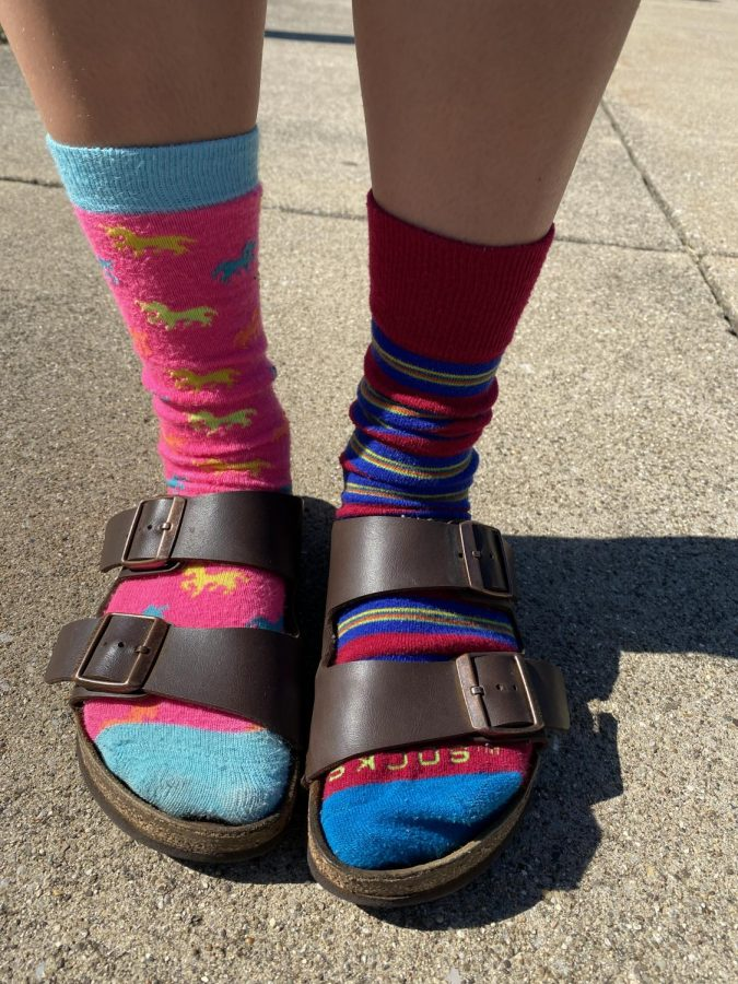 Abbey Potter, 9, shows off her colorful style for Wacky Socks Day during Spirit Week.