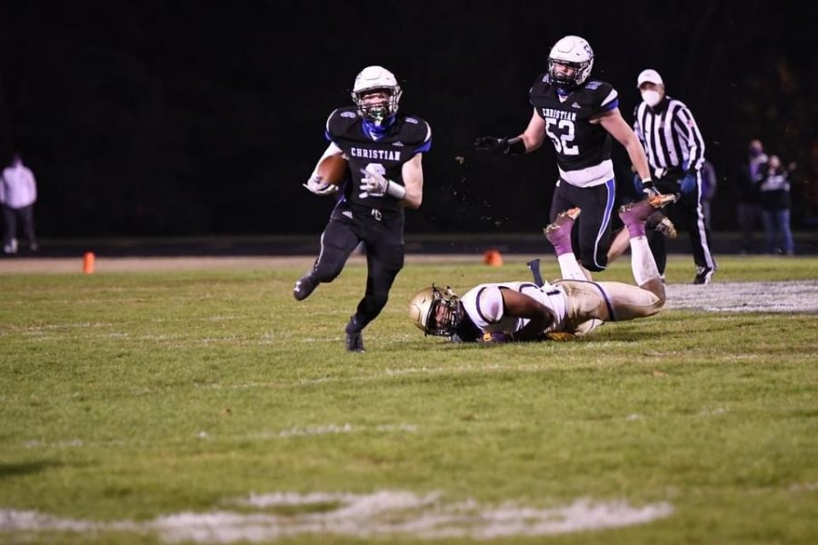 Parker Chaney, 9, and Matthew Potter, 9,  maneuver around a Somerset player in the district championship game.