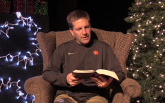 Coach Fugmann joins other teachers in reading the Christmas story from Luke 2.