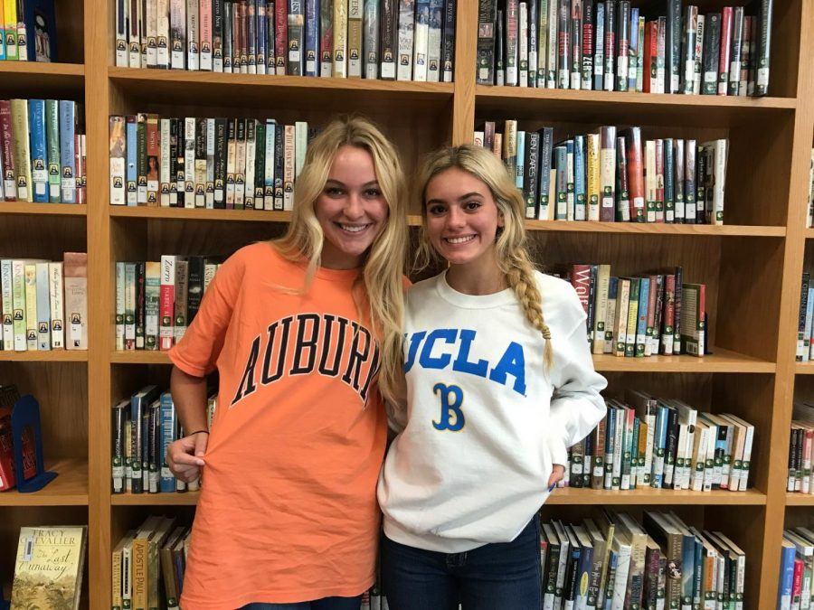 Rachel Young, 12, and Haily Miller, 12, show off their college colors.