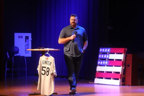 Baseball Coach Matt Ginter talks to Junior High Chapel about his memories of when he was in New York on Sept. 11, 2001.