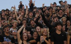 The student section gets excited during the Catholic game.