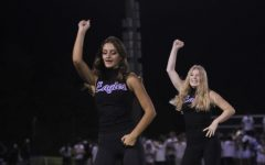Anna Kate Combs, 11, and Taylor Logan, 11, perform with the dance team during halftime of the Catholic game.