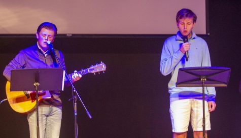 Jake Merryman, 11, and Jack Roth, 12, help lead worship in Chapel.
