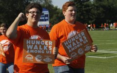 Ben Royse, 12, and Josh Gooch, 10, make their way around the track during the Hunger Walk.